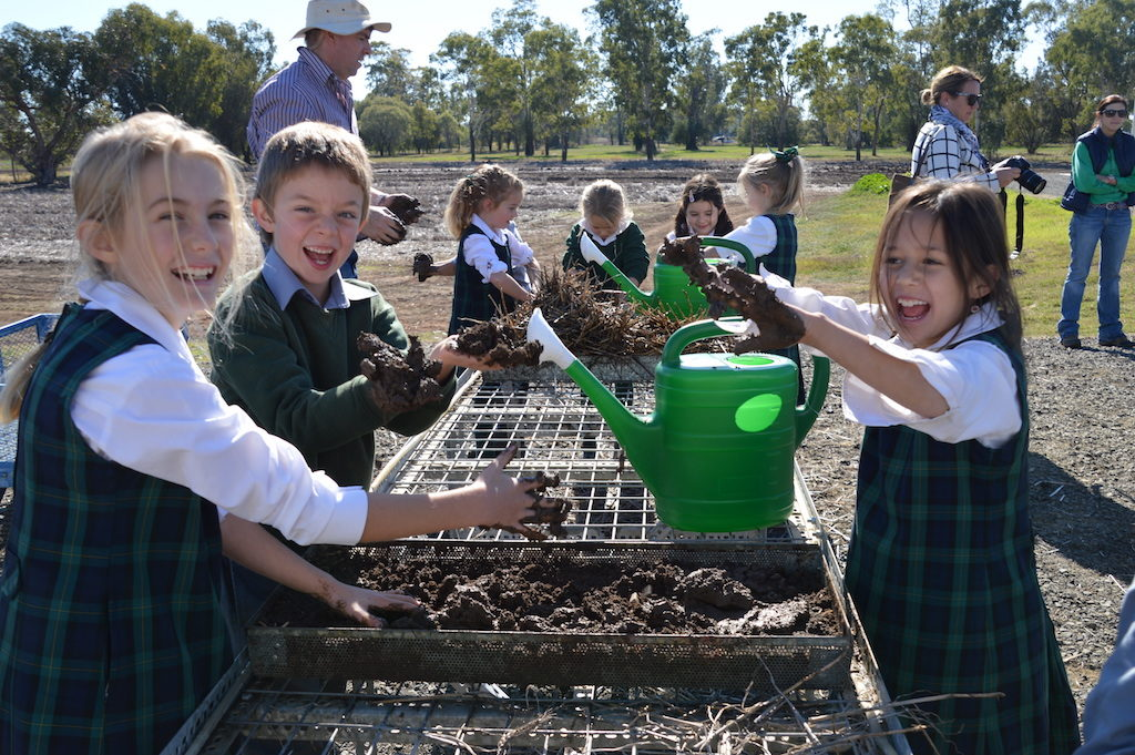 Fairfax Public School students have fun with mud.